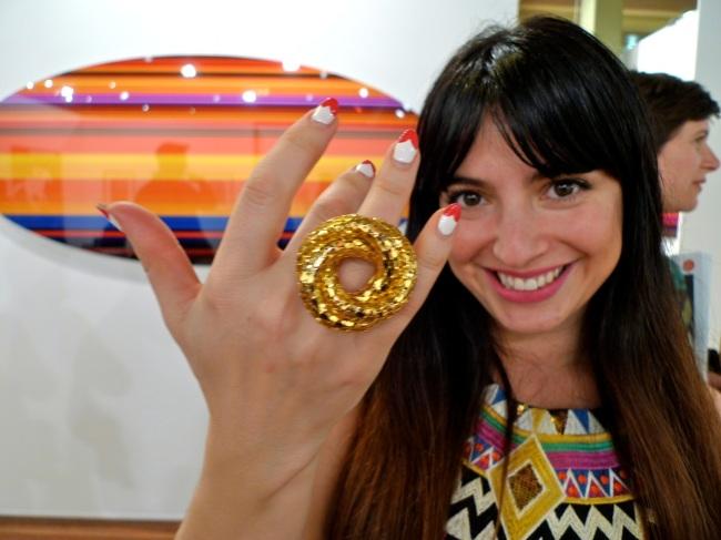 Elle Zoltak flashes her ring