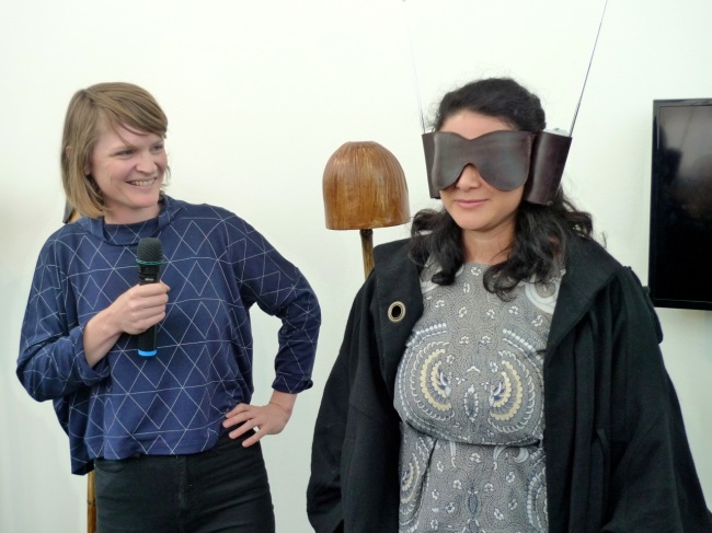 Caitlin blindfolds the Curator Kristi Monfries