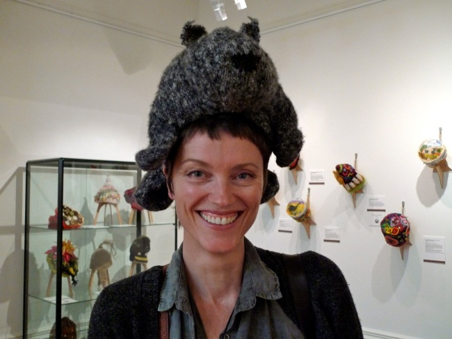 Caitlin Murray modelling a wombat beanie