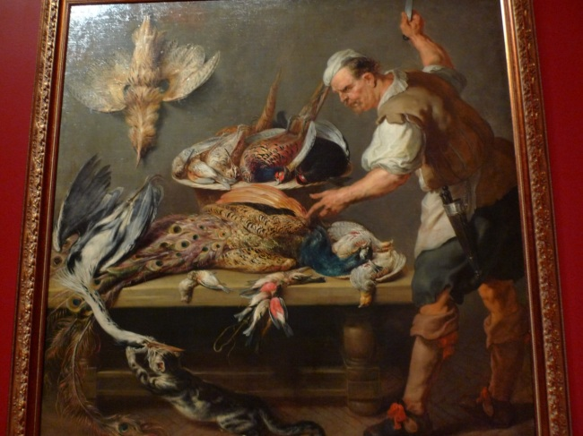 Cook at a kitchen table with dead game by Frans Synders, 1637