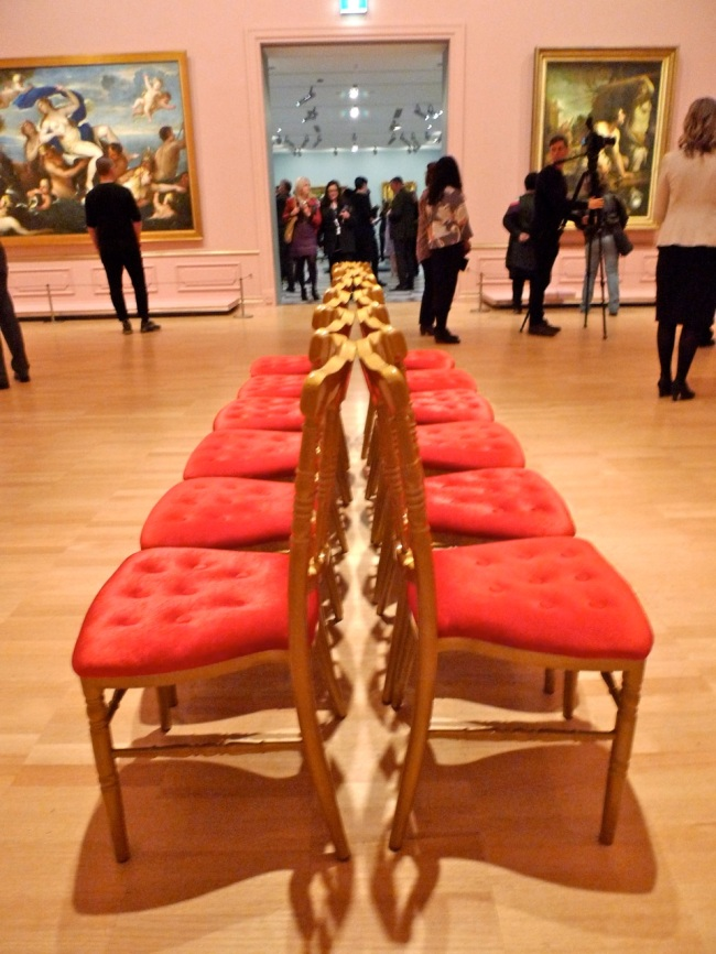 Line of chairs with vagina like opening