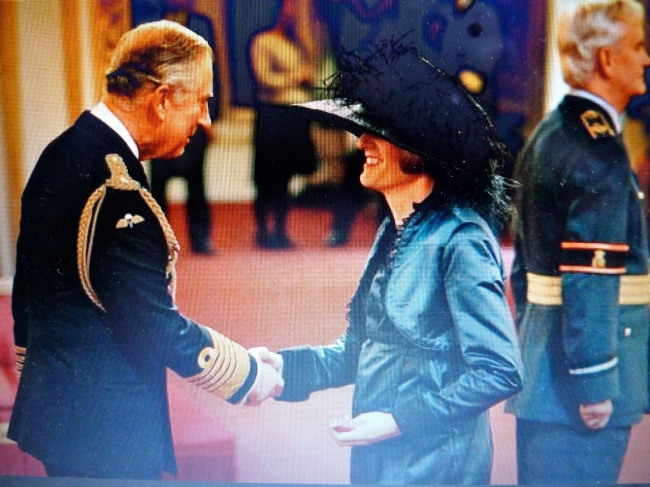 Prince Charles couldn't get the CBE Ribbon over Claire's hat