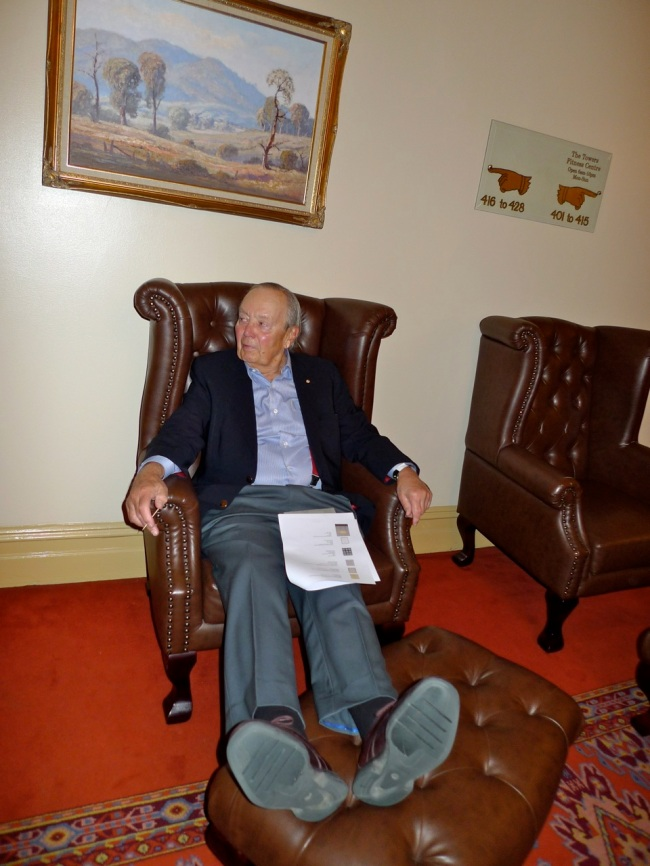 Laurence G Cox AO puts his feet up