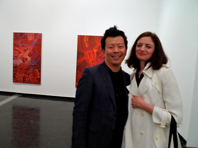 Terry Wu and Zara check out works by Teresa Baker